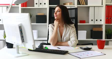 flowerpots : businesswoman sitting in office-chair and looking away