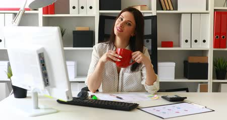 flowerpots : businesswoman with cup smiling at camera in office