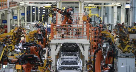 entellektüel : Assembly line production of new car. Automated welding of car body on production line. robotic arm on car production line is working Stok Video