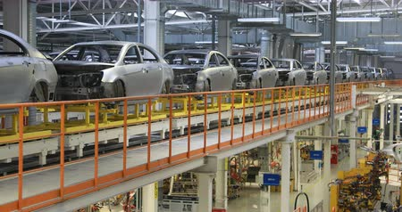 hull : body of car on conveyor Modern Assembly of cars at plant. automated build process of car body. Stock Footage