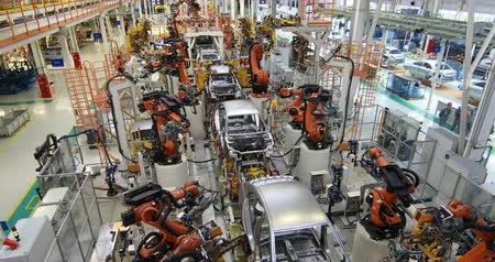 robots : Modern technology of Assembly of cars. The plant of the automotive industry. Shop for the production and Assembly of machines top view. The process of welding parts of the car