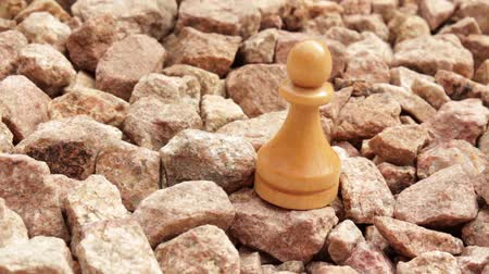 usual : Chess a pawn on stones Stock Footage