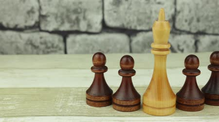 usual : Chess white king and black pawns Stock Footage