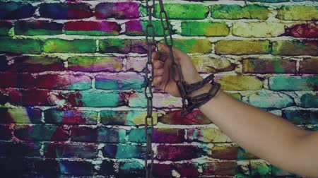 pain free : The chained hand on a color background
