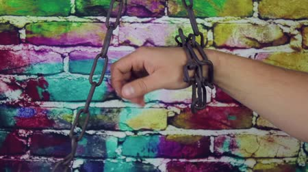 pain free : The chained hand on color background