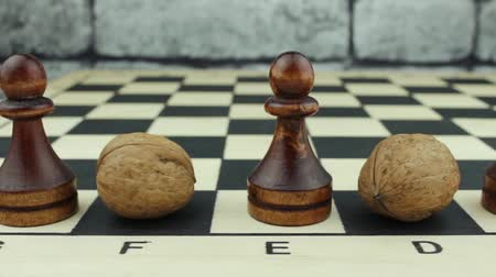 usual : The concept of the pawn with nuts Stock Footage