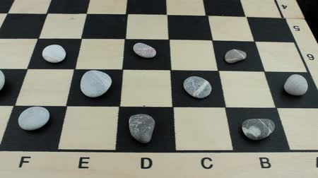 sivilceli : River stones on a chessboard