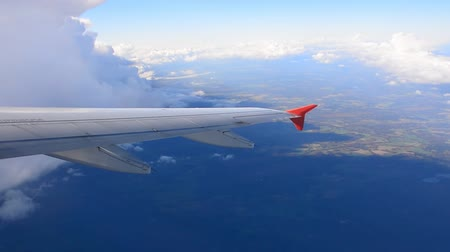 Aircraft makes the climb with a turn through the clouds. The view from an airplane window. 影像素材