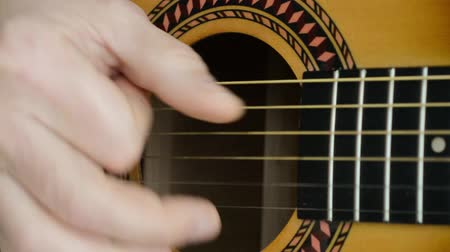 Acoustic Guitar Strumming. Close-up of a hand strumming classical guitar. 影像素材