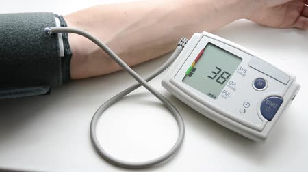 A man is measuring blood pressure and heart-rate