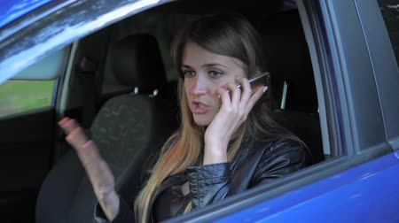 wicked : Young Attractive Woman Sits In A Parked Car And Swears By Phone