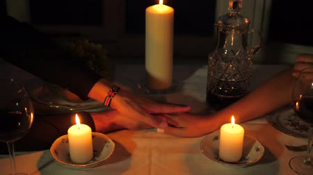 took : Close up Of Mans Hand Takes The Womans Hand Over The Table Candles