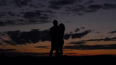 escarlate : The Dark Silhouette Of Romantic Couple Dance And Swirl In A Scarlet Sunset Stock Footage