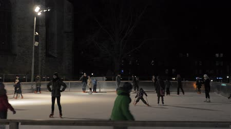 escorregadio : Tallinn, Estonia-December 25,2017: Night Skating Rink Where People Ride On Skate Stock Footage