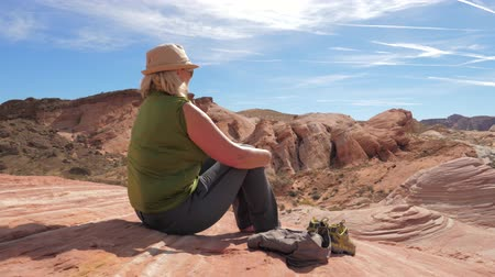 took : Active Woman Tourist Sitting Resting On Red Rock And Admiring Views Of Canyon Stock Footage