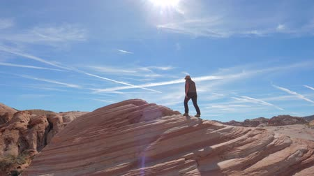 took : Sports Hiking Woman Climbs Up The Red Rock Background The Sky Slow Motion 4K Stock Footage
