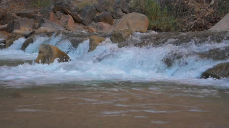 muddy : Rapid In The Mountains With Bubbling Water In A Super Slow Motion 180fps Stock Footage