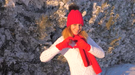 enjoys : Lovely Woman Smiling With Hands Making Heart In Winter Outdoor Tale 4K Stock Footage