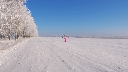 szron : Playful Woman Running And Spinning In Winter On Snow In Field, Hands In Side.