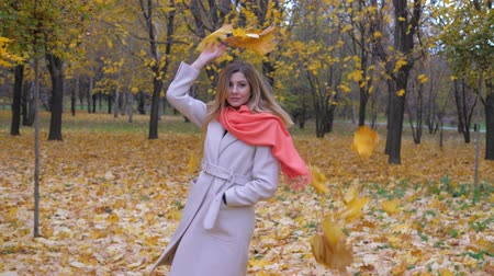 throws : Lovely Lady In A Beige Coat And Orange Scarf Throws Of Autumn Yellow Leaves 4K