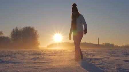 kicked : Woman In Winter Field At Sunset Kicked Snow And Glittering Snowflakes And Frost