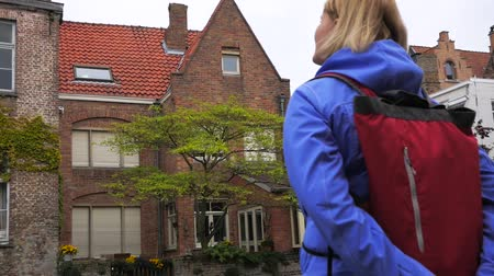 bruges : Camera Movement Around Standing In The Place Of Women Tourists Looks To landmark