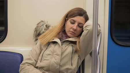 handrails : Closeup Of A Sleeping Caucasian Woman In A Warm Jacket In Train Subway Stock Footage