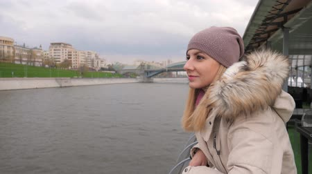 enjoys : Woman Standing To A River Embankment And Enjoying The Beautiful Views Of City 4k