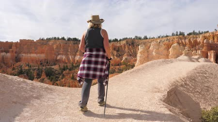 goes : Woman Hiking On A Scenic Footpath Trail In Bryce Canyon Park Stock Footage