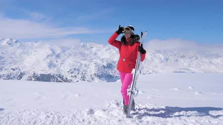 glacier point : Woman Holding Ski, Wearing A Ski Mask, Standing On A Mountains Background