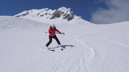 enjoys : Beginner Skier Woman Turns Right and Left on Ski Slope Without Help of Ski Poles