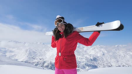 glacier point : Smiling Woman Skier Stands On A Peak Mountain, Holding Skis On Her Shoulders Stock Footage