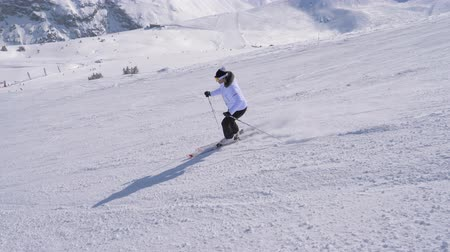 blood sport : Sporty Woman Skier Professionally Carving Down The Slope In The Mountains