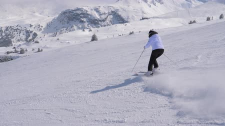 blood sport : Elegant Lady Skier Professionally Carving Down The Slope In The Mountains Stock Footage