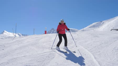 blood sport : Mature Fat Woman Alpine Skier Professionally Carving Down The Slope In Mountains Stock Footage