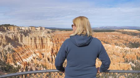 admires : A Mature Fat Woman Admires The Natural Beauty Of The Bryce Canyon Stock Footage