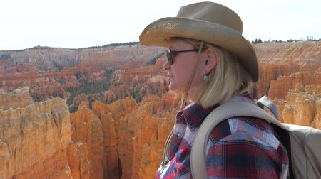 enjoys : Closeup Portrait Of A Woman Hiker In The Background Of Bryce Canyon
