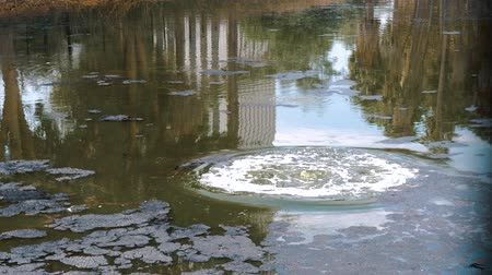 pocsolya : Huge Air Bubbles Burst On The Surface Of The Lake In The Oil Field Stock mozgókép