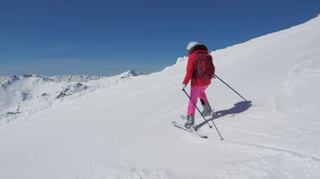 blood sport : In Motion Woman Skier Skiing Down The Steep Slope Of The Mountain Resort