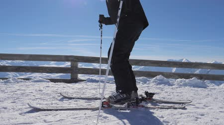 ski boots : Skier At The Top Of The Mountain Fastens Ski Boots On The Ski Fastening