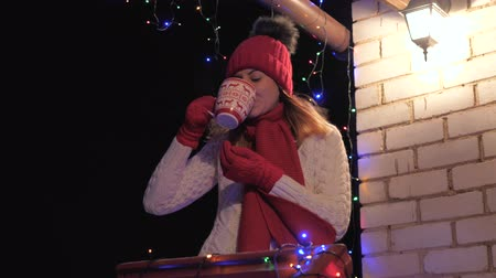 veranda : In The Evening A Woman On The Veranda In Winter In A Sweater Drink Hot Coffee Dostupné videozáznamy