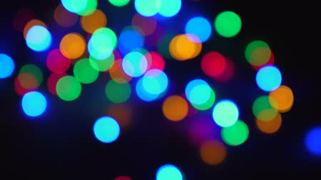 sicim : Blurred Twinkling Multi-Colored Holiday Lights On Black Background