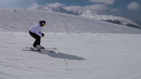 blood sport : The Movement Of The Skier Skiing Down The Slope In The Mountains Ski Resort Stock Footage