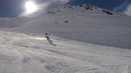 blood sport : Skier Fast Skiing Down The Hill Spray Snow Powder On Turns