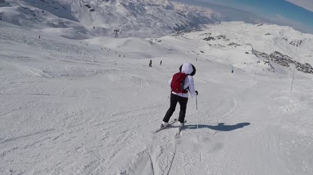 blood sport : Old Woman Skier Skiing Down With Difficulty On Slope Of The Mountain In Winter