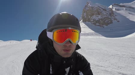 blood sport : Selfie Portrait Of A Skier Quickly Accelerates Skiing In The Mountains In Winter