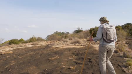 spící : Woman Hiking On A Stone Plateau Of Frozen Lava On A Dormant Volcano In Africa Dostupné videozáznamy