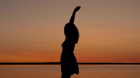emelt : Happy Woman Runs To The Sunset To The Beach Raising Her Arms Up And Spinning