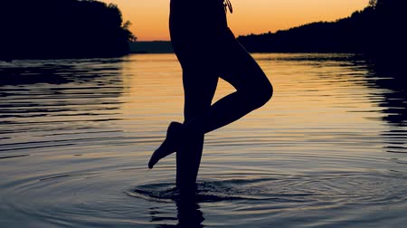 fingertips : Women Feet Gracefully Touches The Water Surface Knee Deep In The Lake At Sunset