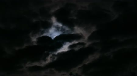 lunar surface : Time Lapse Movement Of The Moon In The Night Sky With Clouds